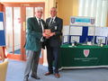 Club Captain Eddie Galjaard receiving the Plaque from President John White
